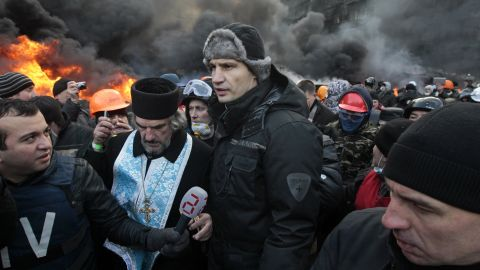 Opposition leader Vitali Klitschko, center, addresses protesters near the burning barricades between police and protesters in central Kiev on January 23.