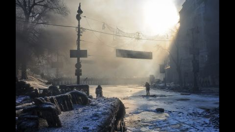 A line of Ukrainian riot police block a road on January 24.