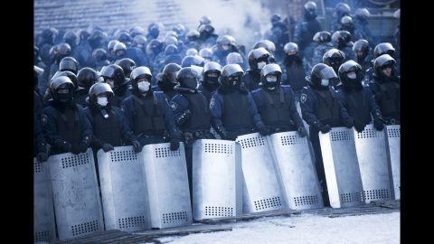 Riot police stand guard near Dynamo Stadium on January 24.