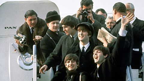 """The Beatles arrive in New York on February 7, 1964. The band from Liverpool, England, already had the No. 1 U.S. single, """"I Want to Hold Your Hand,"""" but its U.S. visit confirmed that """"Beatlemania"""" had made its way across the pond."""