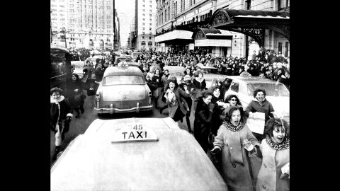 Fans run to catch a glimpse of The Beatles while the band was in New York.