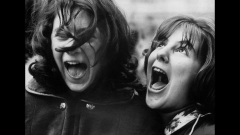 Ecstatic fans await The Beatles outside the Plaza Hotel, where the band was staying in New York during its tour.