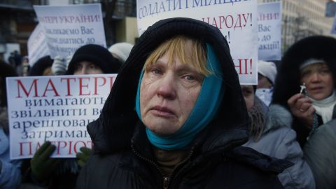 Ukrainian Oksana Tikhomirova cries as she urges riot police to stop the violence outside a government district in central Kiev on January 24.