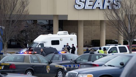 Authorities and emergency vehicles gather outside the mall.