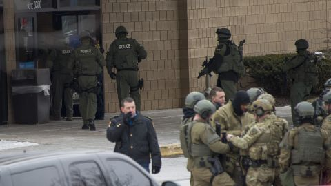 Police enter the Sears department store.