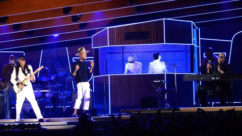 """From left, Nile Rodgers, Pharrell Williams, Daft Punk and Stevie Wonder rock the crowd with a set that included the 2013 single """"Get Lucky."""" The song won record of the year. Daft Punk also won album of the year for """"Random Access Memories."""""""