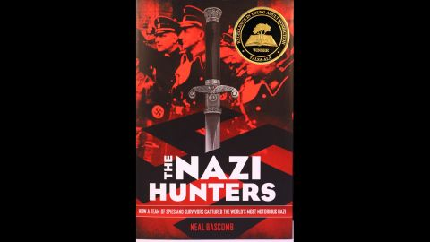 """""""The Nazi Hunters: How a Team of Spies and Survivors Captured the World's Most Notorious Nazi,"""" written by Neal Bascomb, is the 2014 YALSA Award for Excellence in Nonfiction for Young Adults winner."""