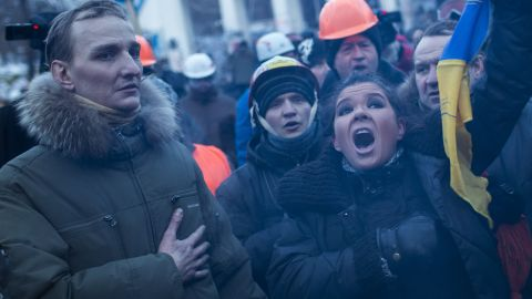 KIEV, UKRAINE - JANUARY 27: Ruslana Lyzhychko, the 2004 Eurovision Song Contest winner, sings the Ukrainian national anthem on Grushevskogo Street on January 27, 2013 in Kiev, Ukraine. Unrest is spreading across Ukraine, with activists taking over municipal buildings in several towns and cities including the east of the country where President Viktor Yanukovych has enjoyed strong support. (Photo by Rob Stothard/Getty Images)