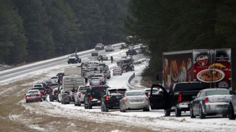 Vehicles sit backed up on a snow covered US Highway 280 in Chelsea, Alabama, on January 28.