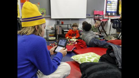 """Gavin Chambers plays an electronic game January 29 at Oak Mountain Intermediate School in Indian Springs, Alabama. The <a href=""""http://www.cnn.com/2014/01/28/us/winter-weather/index.html"""">severe weather forced thousands</a> of students to spend the night in various school buildings across the state."""