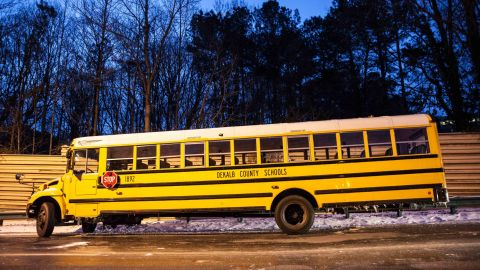 A DeKalb County school bus sits abandoned near Interstate 285 in Dunwoody on January 29.