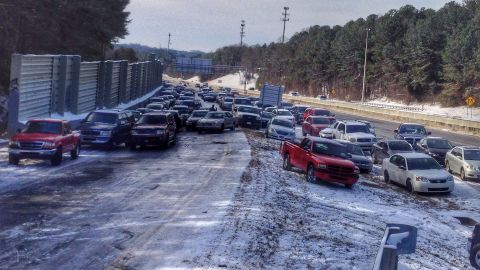 """While walking to the grocery store in Roswell, Georgia, Smith Culberson came across <a href=""""http://ireport.cnn.com/docs/DOC-1079497"""">an entire highway of abandoned vehicles</a>. """"Most cars couldn't drive up the exit ramp because of the ice,"""" he said."""