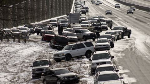 """As of Wednesday afternoon, hundreds of cars were still stranded on Atlanta's interstates, as seen in this photo taken on a GA 400 exit by iReporter <a href=""""http://ireport.cnn.com/docs/DOC-1079567"""">Dylan Wintersteen</a>. """"It's bizarre to see all the cars people abandoned and just left last night,"""" he said."""