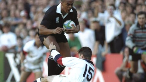 This image of Lomu bulldozing through the tackle of hapless England fullback Mike Catt as he scored one of his four tries in the semifinal in Cape Town has become one of the most iconic moments in rugby history.
