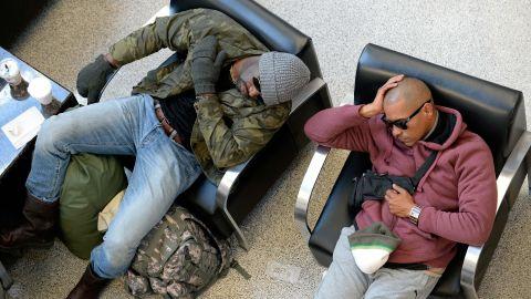 Travelers wait out flight delays at Hartsfield-Jackson Atlanta International Airport on January 30.