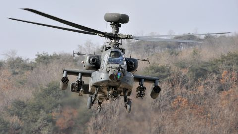 A US Apache helicopter takes to the air during an aerial gunnery exercise at a military firing range in Pocheon, near the heavily-fortified border with North Korea, on January 23, 2009.  The new US administration will make North Korea's nuclear disarmament a priority despite other pressing world problems, South Korea's chief nuclear negotiator said.  AFP PHOTO/JUNG YEON-JE (Photo credit should read JUNG YEON-JE/AFP/Getty Images)