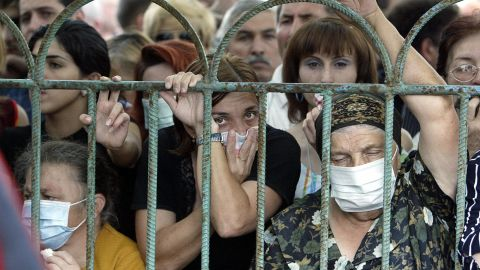 People look for their relatives among the bodies of the Beslan siege victims at the morgue in Vladikavkz, North Ossetia, on September 4, 2004.