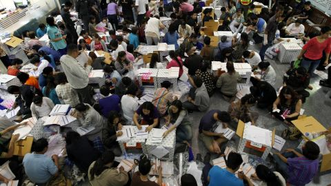 Thai electoral officials prepare material for the general elections at a district office in Bangkok on February 1.