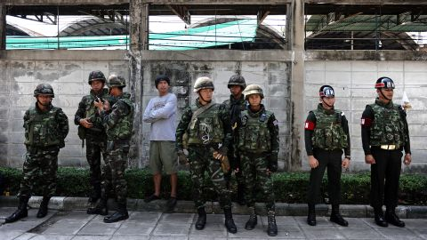Thai soldiers stand outside a closed polling station on February 2.