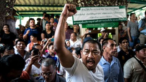 A man yells at police and officials as residents protest over not being able to cast their ballots.