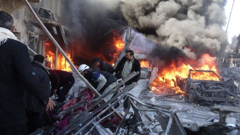 Medical personnel look for survivors after a reported airstrike in Aleppo on Saturday, February 1.