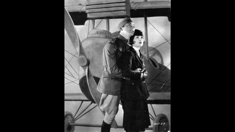 """<strong>""""Wings"""" (1929):</strong> The first Academy Awards were given out at a dinner on May 16, 1929. The best picture winner was 1927's """"Wings,"""" a film about World War I pilots starring Clara Bow, right, Charles """"Buddy"""" Rogers, left,  Richard Arlen and Gary Cooper. Even today, the silent film's aerial sequences stand out as some of the most exciting ever filmed. Another film, """"Sunrise,"""" was given an Oscar as most """"unique and artistic production,"""" an honor that was eliminated the next year. The academy didn't begin using a calendar year for awards until movies made in 1934 (with ceremonies held in 1935). While the Academy awards the Oscars for work from the previous year, we are listing these with the years of the actual ceremony to avoid confusion."""