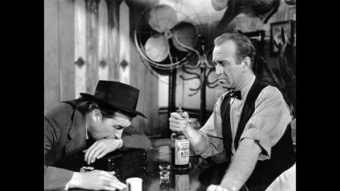 """<strong>""""The Lost Weekend"""" (1946):</strong> With World War II coming to an end, Hollywood turned to dark subject matter, such as alcoholism in Billy Wilder's """"The Lost Weekend."""" Star Ray Milland, left, won the best actor award as a writer on a binge. Howard Da Silva was the bartender."""