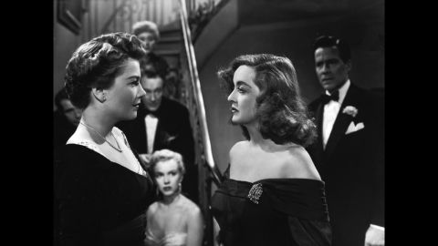 """<strong>""""All About Eve"""" (1951):</strong> Director Joseph L. Mankiewicz's screenplay about an aging actress (Bette Davis, right) battling a scheming newcomer (Anne Baxter) remains one of the most quotable movies ever almost 65 years after its release. """"All About Eve"""" held the record for a movie with the most Oscar nominations (14) until """"Titanic"""" tied it in 1997. A young Marilyn Monroe, center, also attracted attention in an early role. As Margo Channing (Davis' character) would say, """"Fasten your seat belts, it's going to be bumpy night!"""""""