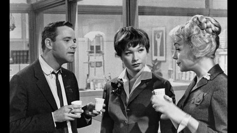 """<strong>""""The Apartment"""" (1961):</strong> Long before """"Mad Men,"""" Billy Wilder's """"The Apartment"""" skewered corporate life of the early 1960s. Up-and-comer Jack Lemmon stays busy loaning his apartment key to company men who need a place to cheat on their wives. He falls for Shirley MacLaine, center, who is having an affair with one of the bosses (""""My Three Sons' """" Fred MacMurray in an unsympathetic role)."""