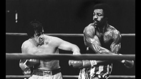 """<strong>""""Rocky"""" (1977):</strong> Sylvester Stallone, left, as struggling boxer Rocky Balboa, gets his shot at the championship against Carl Weathers as Apollo Creed in this best picture winner. Like its hero, """"Rocky"""" was an underdog, a low-budget film written by Stallone, then an unknown actor, that became one of the decade's biggest sleeper hits. Stallone would go on to make five sequels."""
