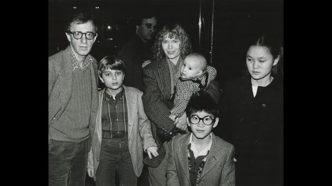 Mia Farrow has had 15 children, including three biological offspring with former husband composer Andre Previn, son Satchel (later known as Ronan) born during her relationship with Allen and several children she adopted. Here, she poses with Allen and her children, from left, Misha, Dylan (in Farrow's arms), Fletcher, and Soon-Yi in New York in 1986. The man in center background is unidentified.