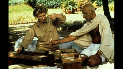 """<strong>""""Gandhi"""" (1983):</strong> Director Richard Attenborough's epic, three-hour film about the life of Mohandas K. """"Mahatma"""" Gandhi won eight Oscars. Ben Kingsley, here with Candice Bergen, played the inspiring leader who used nonviolent tactics to help establish the modern country of India. Among the films it beat for best picture: """"E.T. The Extra-Terrestrial"""" and """"Tootsie."""""""