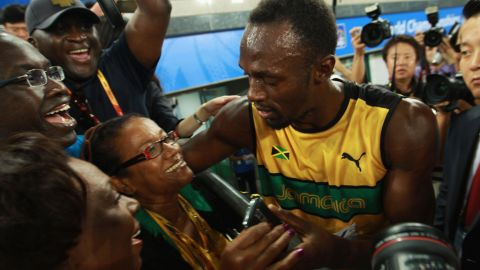 Jamaican sprinter Usain Bolt celebrates victory and a new world record with his mother, Jennifer Bolt, following a race at the World Championships in Daegu, South Korea, in 2011.