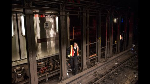A New York City transit official checks the tracks at the Times Square subway station on February 5.