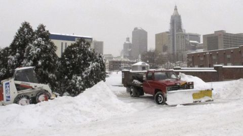 Crews clear snow as ice pellets fall in Hartford, Connecticut, on February 5.