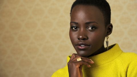 """Lupita Nyong'o, a cast member in """"12 Years a Slave,"""" poses for a portrait on day 3 of the 2013 Toronto International Film Festival on Saturday, Sept. 7, 2013 in Toronto. (Photo by Chris Pizzelloi/Invision/AP)"""