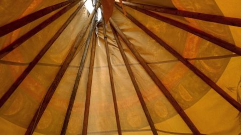 After helping to construct a teepee with a guest presenter who came to the school, a second-grade student took this picture to show the view from the inside.