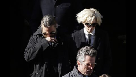 """Actor Joaquin Phoenix, left, exits the church. Phoenix appeared with Hoffman in """"The Master."""""""