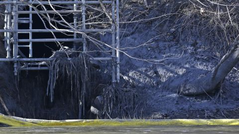 A pipe from the Dan River power plant where coal ash spilled is seen along the Dan River on February 5.