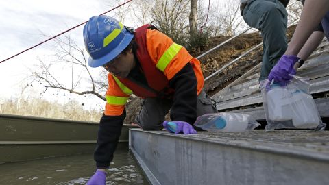 Didi Fung, a contractor for the Environmental Protection Agency, collects water samples from the Dan River on February 5.