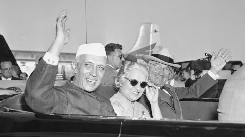 HOLD FOR RELEASE UNTIL 12:01 EDT AM TUESDAY, NOV. 24, 2009 ** FILE - In this Oct. 11, 1949, file photo Prime Minister Jawaharlal Nehru of India, left, Indian Ambassador to the United States and Nehru's sister, Mme. Vijaya Pandit, and President Harry S. Truman, right, wave from an automobile as they leave National Airport in Washington. Nehru arrived from London in the president's personal plane for a good will visit. The State Dinner for Nehru, India's first prime minister, was notable because it wasn't at the White House. The mansion was being repaired and Truman and first lady Bess Truman had decamped to Blair House, the government guest house across the street. (AP Photo/File)