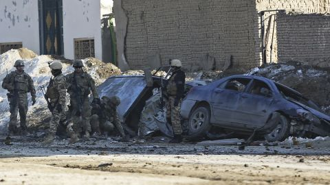 U.S. soldiers and Afghan security forces search the site of a suicide bombing in the Afghan capital Kabul, Afghanistan, on February 10, 2014.