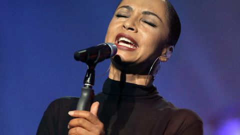 """Nigerian-British singer Sade was<a href=""""http://www.washingtonpost.com/blogs/click-track/post/letting-down-her-guard-only-sade-knows-how-long-shell-stand-in-the-spotlight/2011/06/22/AGIm5cfH_blog.html"""" target=""""_blank"""" target=""""_blank""""> raised in Holland-on-Sea</a> by her mother."""