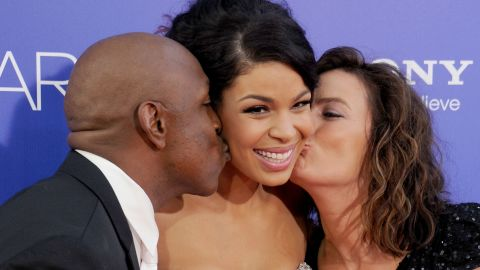 """Actress and recording artist Jordin Sparks receives a kiss from her dad, former football player Phillippi Sparks, and mom, Jodi Sparks, at the premiere of """"Sparkle."""""""