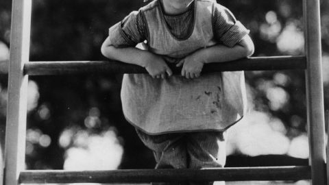 circa 1933: Shirley Temple (1928 - ) the American child star at five years of age, standing on her climbing frame at home. (Photo by Hulton Archive/Getty Images)