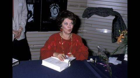"""Temple Black signs copies of her book """"Child Star"""" in 1988."""