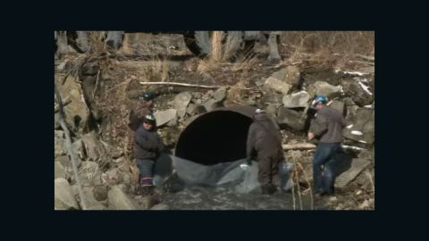 More than 100,000 gallons of coal slurry blackened a creek in West Virginia.