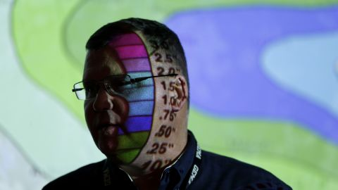 Weather data is projected onto the face of Clint Perkins, director of state operations for the Georgia Emergency Management Agency, as he works in Atlanta on February 11.