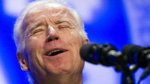 Joe Biden laughs while speaking at the UAW National Community Action Program Conference in Washington in February 2014.