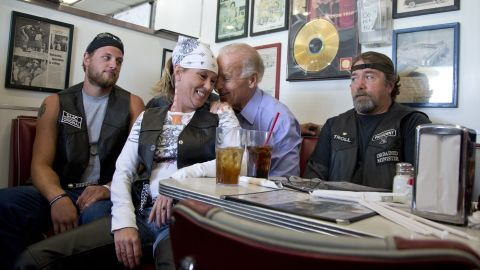 Joe Biden talks to customers, including a woman who pulled up her chair in front of where he was sitting, during a campaign stop at Cruisers Diner in Seaman, Ohio, in September 2012.